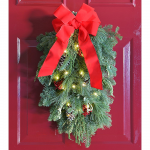 Boughs & Berries Door Greeter with Bow & Lights